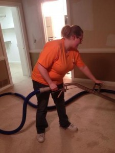 Water Damage Restoration Technician Vacuuming Up Water