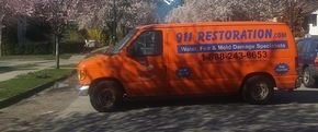 Water Damage Restoration Vehicle At Residential Job